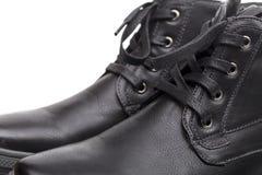 Laarzen op de witte achtergrond Royalty-vrije Stock Foto's