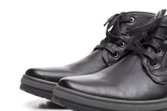 Laarzen op de witte achtergrond Stock Foto's