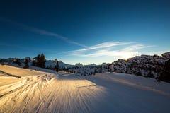 Laat op de skihelling stock fotografie