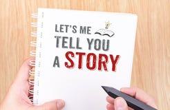 Laat ` s me u het verhaalwerk aangaande wit het notitieboekjeverstand van het ringsbindmiddel vertellen Royalty-vrije Stock Foto