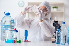 The lab assistant testing water quality. Lab assistant testing water quality royalty free stock image