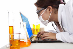 Lab assistant works with laptop Royalty Free Stock Image