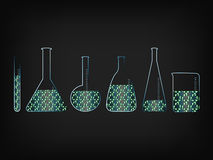 Lab bottles with green recycle symbol fill. Lab bottles with recycle symbol fill, concept of green economy innovation and experiments Royalty Free Stock Image
