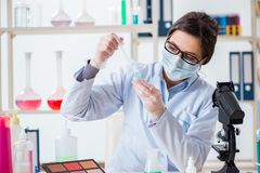 The lab chemist checking beauty and make-up products. Lab chemist checking beauty and make-up products Royalty Free Stock Image