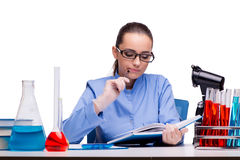 The lab chemist working with microscope and tubes Royalty Free Stock Photo