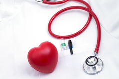 Lab coat with heart. Lab coat with stethoscope and a red heart stock photography