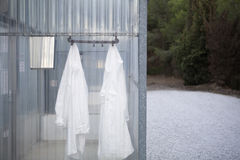 Lab Coats Hanging In Change Room Stock Photography
