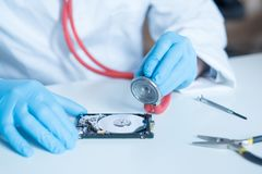 Lab engineer working on broken hard disk Stock Images