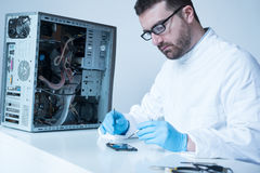 Lab engineer working on broken hard disk Royalty Free Stock Images