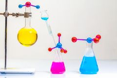 Lab experiments molecule structure with chemical experiment tube. In the science lab with white background royalty free stock photos
