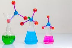 Lab experiments molecule structure with chemical experiment tube. In the science lab with white background royalty free stock photography
