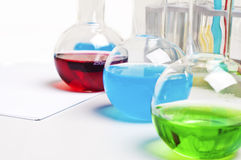 Lab flasks with colored liquids,  lab workplace. Workplace employee lab,flasks with colored liquids, laboratory items Stock Photography