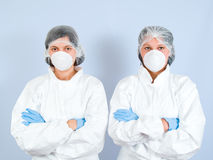 Lab Girls 01. Lab Girls wearing tyvek suit Royalty Free Stock Images
