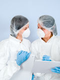 Lab Girls 05. Lab Girls wearing tyvek suit Stock Images