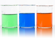Lab glass backlit with reflection. In green ,blue and orange Royalty Free Stock Images