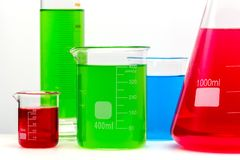 Lab glass set filled with colorful bright substances close up royalty free stock photography