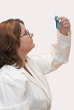 Lab Lady. Scientist at work, showing vial royalty free stock image
