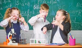 Lab microscope. Student preparing to the exams. Chemistry microscope. Little kids learning chemistry in school lab stock photo