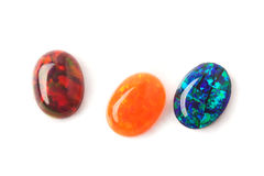 Lab opals. Jeweler stones - lab grown opals of wonderful colors and fire Royalty Free Stock Photo
