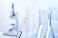 Lab scene with pipette and test tube Royalty Free Stock Photography