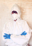 Lab scientist in safety suit. Royalty Free Stock Images