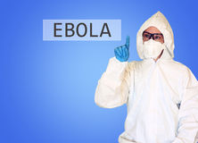 Lab scientist in safety suit drawing word ebola. Royalty Free Stock Photo