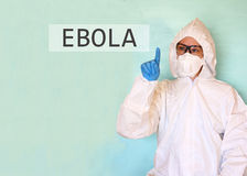 Lab scientist in safety suit drawing word ebola Royalty Free Stock Images