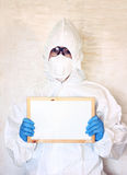 Lab scientist in safety suit holding board Stock Image