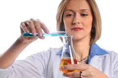 Lab Tech Mixing Liquids Royalty Free Stock Images