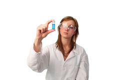 Lab technical performing an experiment. Female Lab technical performing an experiment1 Stock Photo
