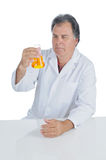 Lab Technician. Examining a beaker of liquid chemicals Royalty Free Stock Images