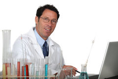 Lab technician. Working away at his laptop Royalty Free Stock Photography