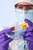 Lab technician with biohazard sample Stock Photos