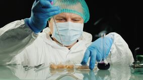 The lab technician checks the quality of the chicken meat in the lab. Food quality control