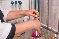 Lab technician doing chemical analysis. Testing chemical composition of the water. stock image