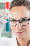 Lab technician holding tube Stock Photography