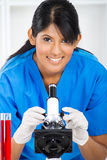 Lab technician using microscope Royalty Free Stock Photos