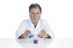 Lab Technician At Work. Lab techinician mixing chemicals during an experiment Royalty Free Stock Image
