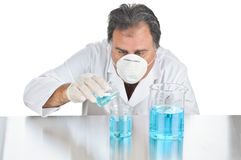 Lab Technician At Work. Lab technician mixing chemicals during an experiment Royalty Free Stock Photos