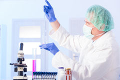 Lab technician working with equipment Stock Photos