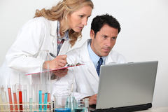 Lab technicians. Working together on research Stock Photo
