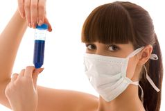 Lab work. Closeup of beautiful lab worker holding up test tube royalty free stock image