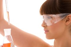 Lab work. Closeup of beautiful lab worker holding up test tube royalty free stock photo