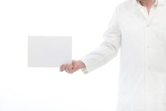 Lab worker holding a small poster in his hand. Lab worker holding a small blank poster in his hand with space to put your message or text Stock Photography