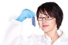 Lab worker holding up test tube. Picture of beautiful lab worker holding up test tube Stock Photos