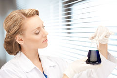 Lab worker holding up test tube Royalty Free Stock Photos