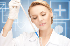 Lab worker holding up test tube Royalty Free Stock Image