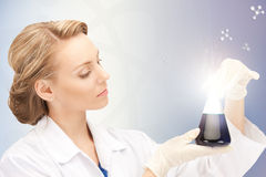 Lab worker holding up test tube Stock Photography