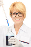 Lab worker holding up test tube Royalty Free Stock Images