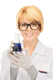 Lab worker holding up test tube Royalty Free Stock Photography